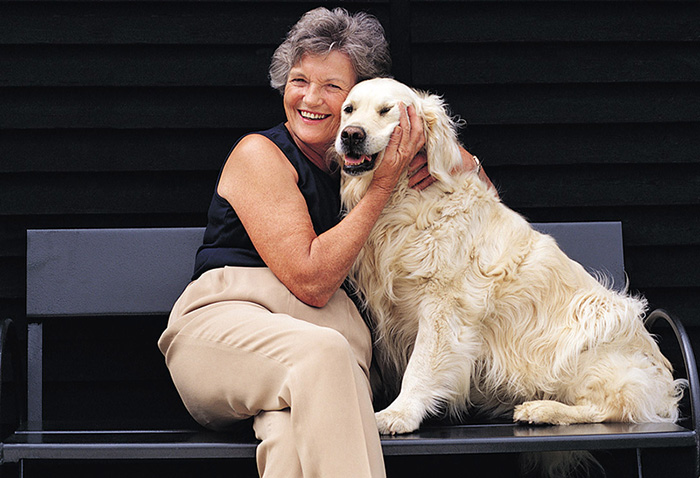 happy senior with pet